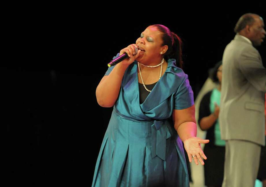 Tiffany Andrews-Woodside, the 2012 Sunday Best Contestant from  BET-TV, sings during the New York State Martin Luther King, Jr. Memorial Observance at the Empire State Plaza Convention Center on Monday, Jan. 21, 2013, in Albany, NY.  Following the event, people marched to the Lincoln Park King Memorial for a wreath-laying ceremony.   (Paul Buckowski / Times Union) Photo: Paul Buckowski / 00020685A