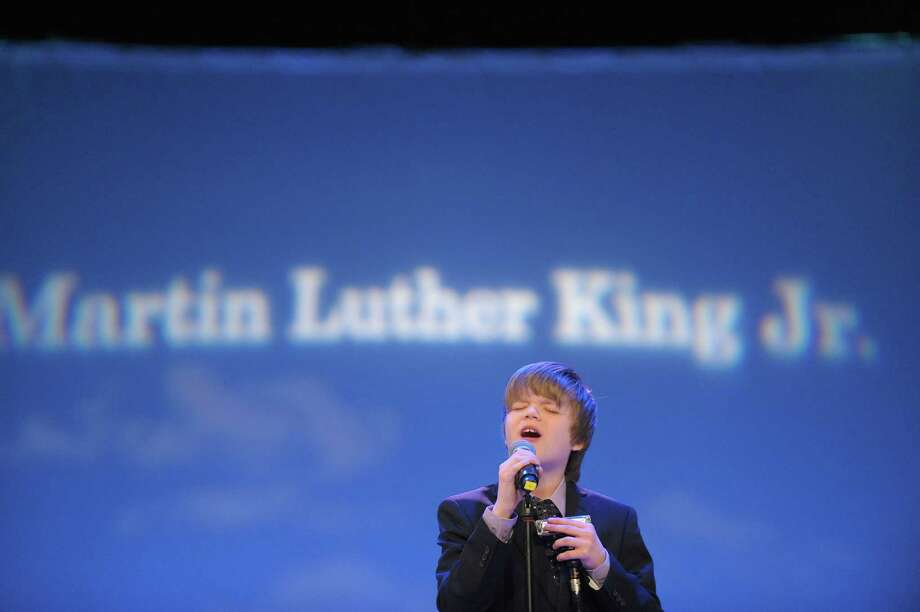 Singer and musician  Joshua King, 12, performs the song ?Precious Lord? during the New York State Martin Luther King, Jr. Memorial Observance at the Empire State Plaza Convention Center on Monday, Jan. 21, 2013, in Albany, NY.  Following the event, people marched to the Lincoln Park King Memorial for a wreath-laying ceremony.   (Paul Buckowski / Times Union) Photo: Paul Buckowski / 00020685A