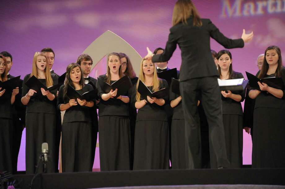 Members of the Buffalo State Chamber Choir perform during the New York State Martin Luther King, Jr. Memorial Observance at the Empire State Plaza Convention Center on Monday, Jan. 21, 2013, in Albany, NY.  Following the event, people marched to the Lincoln Park King Memorial for a wreath-laying ceremony.   (Paul Buckowski / Times Union) Photo: Paul Buckowski / 00020685A