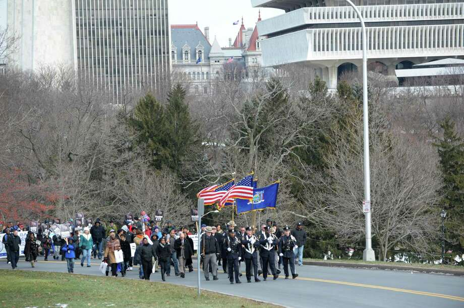 Members of the Albany Police force and state troopers lead the Beloved Community March to the Lincoln Park King Memorial following the New York State Martin Luther King, Jr. Memorial Observance at the Empire State Plaza Convention Center on Monday, Jan. 21, 2013, in Albany, NY.     (Paul Buckowski / Times Union) Photo: Paul Buckowski / 00020685A