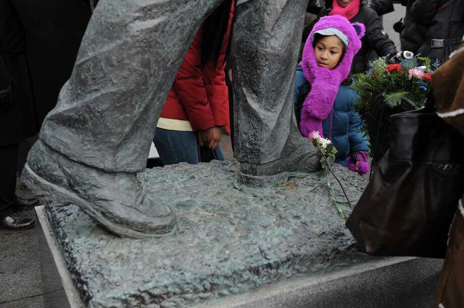 Icesis Hinkson-Serrano, 8, of Albany, looks over the statue of  Martin Luther King, Jr. at the Lincoln Park King Memorial following a wreath-laying ceremony on Monday, Jan. 21, 2013, in Albany, NY. (Paul Buckowski / Times Union) Photo: Paul Buckowski / 00020685A