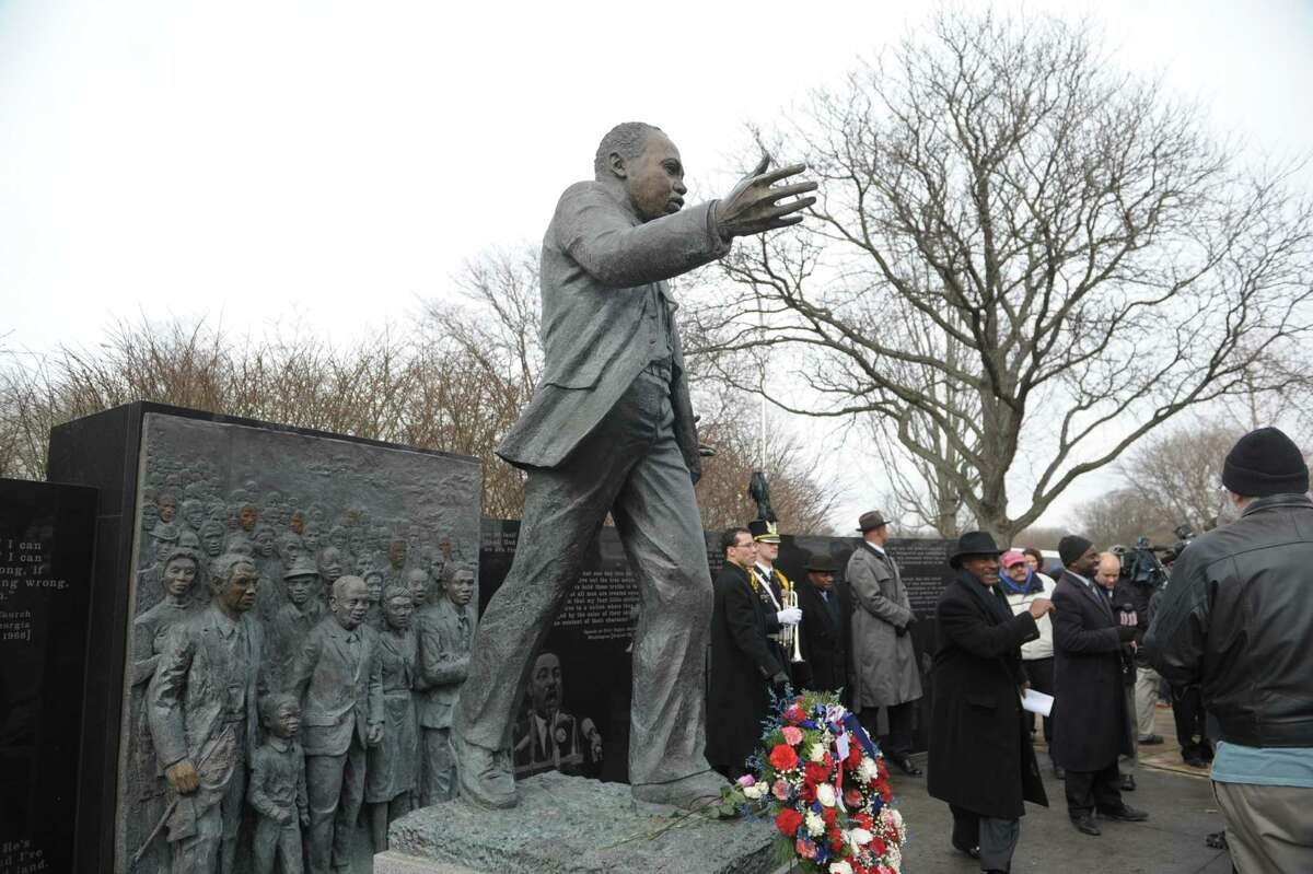 People gather around the statue of Martin Luther King Jr. at the Lincoln Park King Memorial following a wreath-laying ceremony on Monday, Jan. 21, 2013 in Albany, NY. (Paul Buckowski / Times Union)