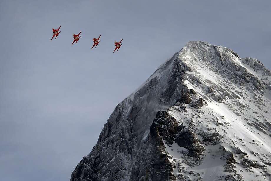 "F5 Tiger fighter jets of the Swiss Air Force or ""Patrouille Suisse"" perform with the Eiger mountain as background on January 19, 2013 prior to the Men's downhill race at the FIS Alpine Skiing World Cup in Wengen. Photo: Fabrice Coffrini, AFP/Getty Images"
