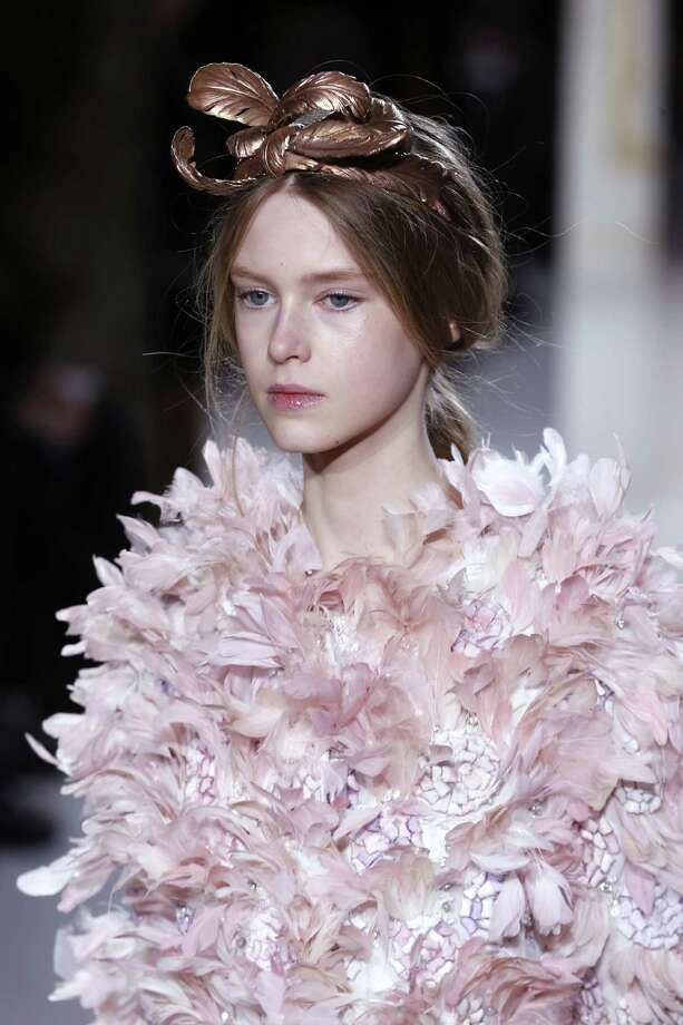 Sometimes,  the look seems ok from the neck up. A model presents a creation by Italian fashion designer Giambattista Valli during the Haute Couture Spring-Summer 2013 collection shows on Jan. 21 in Paris. Photo: FRANCOIS GUILLOT, AFP/Getty Images / AFP
