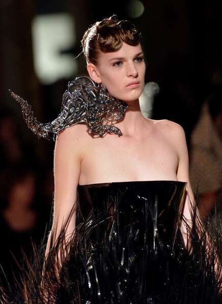 It's bad enough that there's an alien creature eating her neck...A model wears a creation