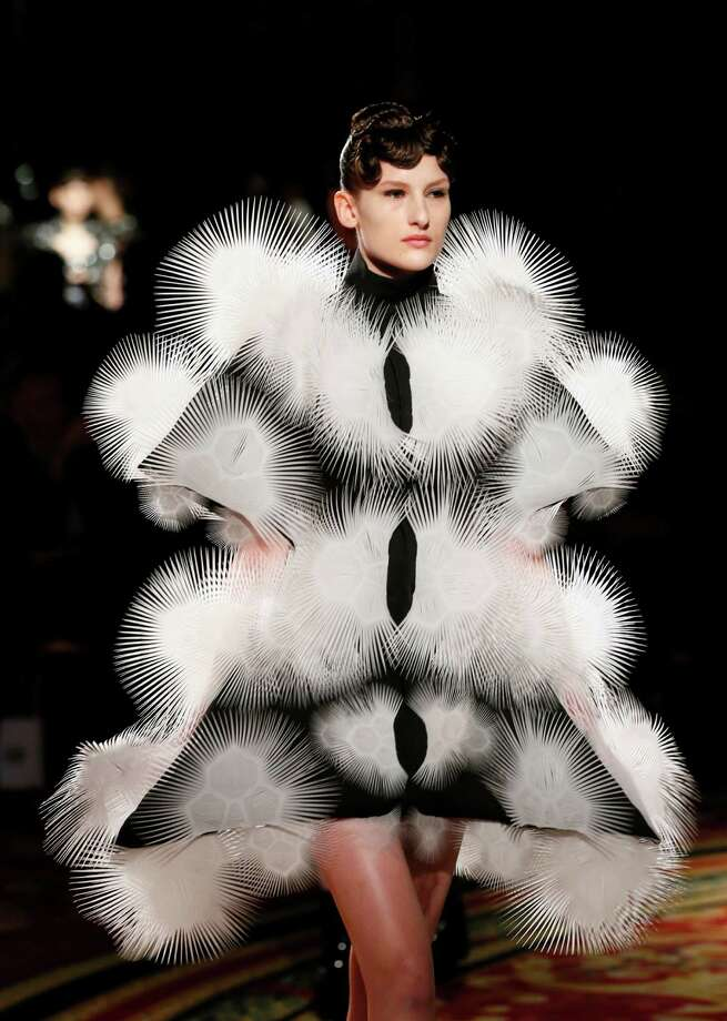 These things look all cute and fuzzy until you realize they're poisonous. A model presents a creation by Dutch designer Iris Van Herpen during the Haute Couture Spring-Summer 2013 collection shows in Paris.  Photo: PATRICK KOVARIK, AFP/Getty Images / AFP