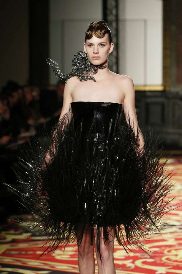 But the dress has already gobbled up her arms and is looking for something else to snack on. Maybe it could eat the Sno Ball dress and spare the model.A model presents a creation by Iris Van Herpen during the Haute Couture Spring-Summer 2013 collection shows on Jan. 21.  Photo: PATRICK KOVARIK, AFP/Getty Images / AFP