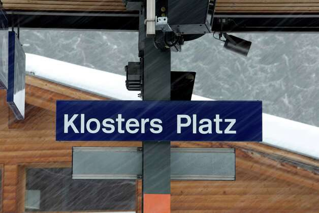 The sign for the Klosters Platz railway station is seen during a snow storm at Klosters, Switzerland, on Monday, Jan. 21, 2013. This week the business elite gathers in the Swiss Alps for the 43rd annual meeting of the World Economic Forum in Davos, the five day event runs from Jan. 23-27. Photographer: Chris Ratcliffe/Bloomberg Photo: Chris Ratcliffe, Bloomberg / Copyright 2013 Bloomberg Finance LP, All Rights Reserved.