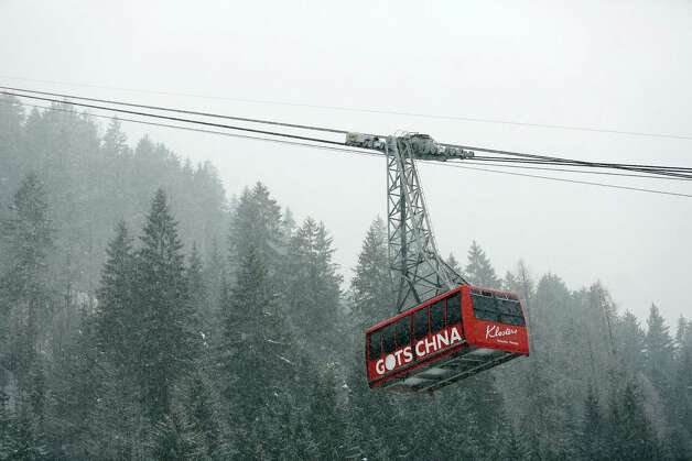 The Gotschna cable car moves down the mountain during a snow storm in Klosters, Switzerland, on Monday, Jan. 21, 2013. This week the business elite gathers in the Swiss Alps for the 43rd annual meeting of the World Economic Forum in Davos, the five day event runs from Jan. 23-27. Photographer: Chris Ratcliffe/Bloomberg Photo: Chris Ratcliffe, Bloomberg / Copyright 2013 Bloomberg Finance LP, All Rights Reserved.