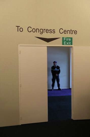 A security officer stands guard inside the media center ahead of The World Economic Forum (WEF) meet