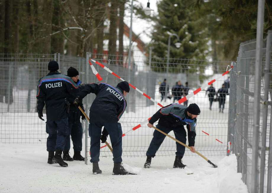 Members of the Swiss police force are seen moving snow from outside the Congress Centre ahead of the World Economic Forum (WEF) meeting in Davos, Switzerland, on Monday, Jan. 21, 2013. This week the business elite gathers in the Swiss Alps for the 43rd annual meeting of the World Economic Forum in Davos, the five day event runs from Jan. 23-27. Photographer: Simon Dawson/Bloomberg Photo: Simon Dawson, Bloomberg / Copyright 2013 Bloomberg Finance LP, All Rights Reserved.