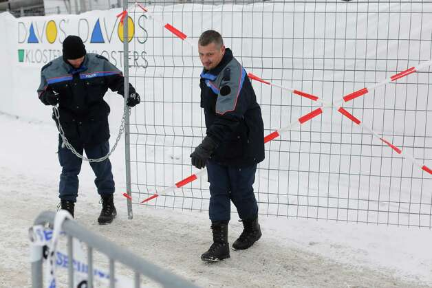 Members of the Swiss police force move a security barrier into position outside the Congress Centre ahead of the World Economic Forum (WEF) meeting in Davos, Switzerland, on Monday, Jan. 21, 2013. This week the business elite gathers in the Swiss Alps for the 43rd annual meeting of the World Economic Forum in Davos, the five day event runs from Jan. 23-27. Photographer: Simon Dawson/Bloomberg Photo: Simon Dawson, Bloomberg / Copyright 2013 Bloomberg Finance LP, All Rights Reserved.