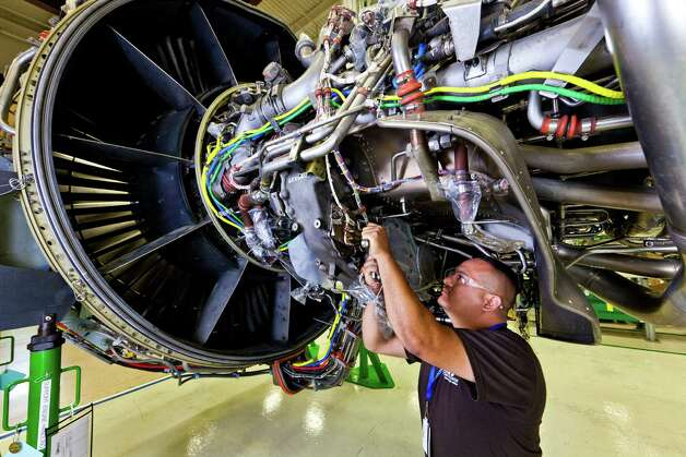 A worker at Port San Antonio's Kelly Aviation Center performs maintanence on a jet engine. Kelly Aviation's Lockheed Martin Corp. has purchased the assets of a similar Canadian facility and will rename it Kelly Aviation Center Montreal. Photo: Jon King Keisling, Kelly Aviation / © Copyright 2010 Jon King Keisling