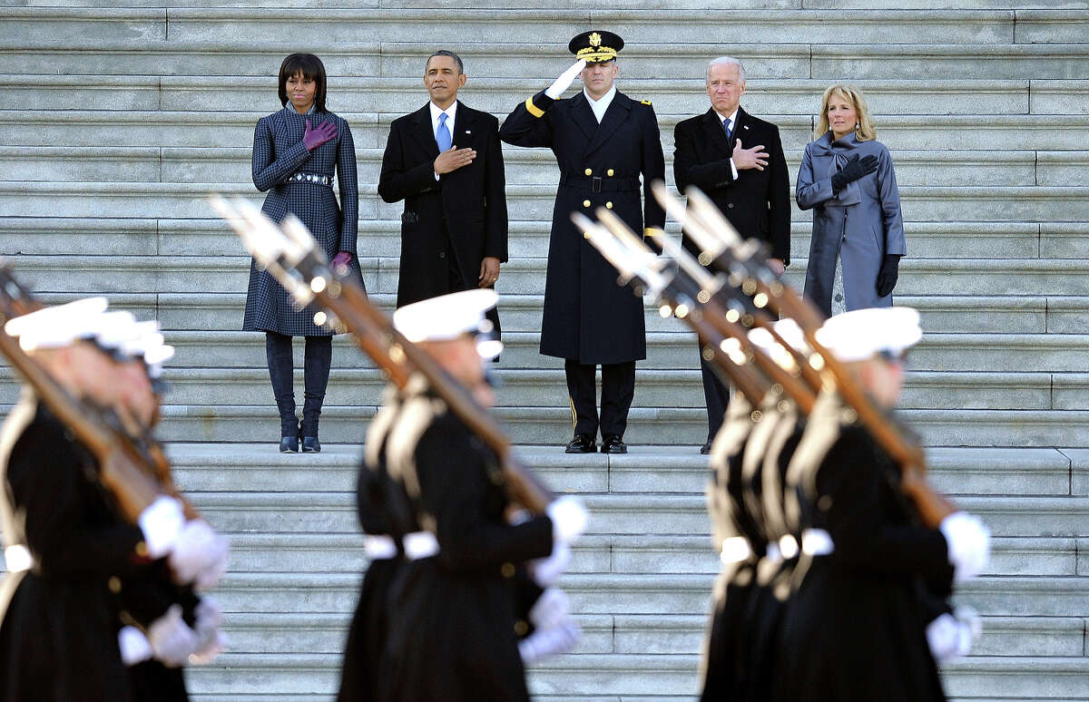 President Barack Obama, first lady Michele Obama, left, Army Major General Michael Linnington, Joint Forces Headquarters, National Capitol Region, center, and Vice President Joe Biden and his wife Jill Biden, place their hands over their hearts as they review the troops following his ceremonial swearing-in during the 57th Presidential Inauguration at the U.S. Capitol in Washington, Monday, Jan. 21, 2013. (AP Photo/Cliff Owen)