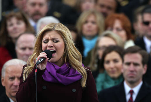 WASHINGTON, DC - JANUARY 21:  Kelly Clarkson performs ?My Country Tis of Thee?during the presidential inauguration on the West Front of the U.S. Capitol January 21, 2013 in Washington, DC.   Barack Obama was re-elected for a second term as President of the United States. Photo: Justin Sullivan, Getty Images / 2013 Getty Images