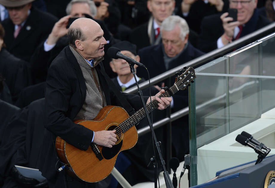Musician James Taylor  sings before US President Barack Obama took the oath of office during the 57th Presidential Inauguration ceremonial swearing-in at the US Capitol on January 21, 2013 in Washington, DC. The oath was administered by US Supreme Court Chief Justice John Roberts, Jr.   AFP PHOTO / Saul LOEB Photo: SAUL LOEB, AFP/Getty Images / 2013 AFP