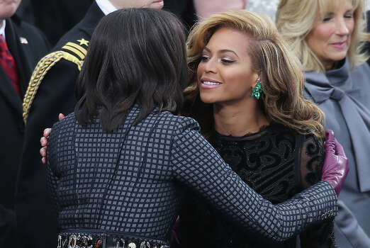 WASHINGTON, DC - JANUARY 21:  First lady Michelle Obama (L) greets singer Beyonce after she performs the National Anthem during the public ceremonial inauguration for U.S. President Barack Obama on the West Front of the U.S. Capitol January 21, 2013 in Washington, DC.   Barack Obama was re-elected for a second term as President of the United States. Photo: John Moore, Getty Images / 2013 Getty Images