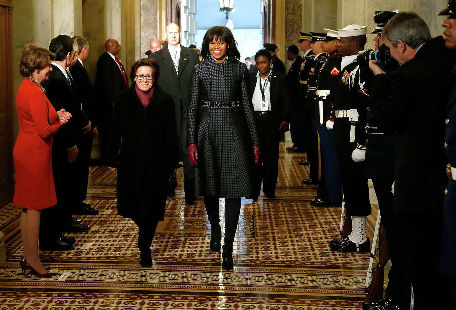 WASHINGTON, DC - JANUARY 21: U.S. first lady Michelle Obama arrives at the carrieage entrance of the U.S. Capitol to begin swearing-in ceremonies on January 21, 2013 in Washington, DC.  U.S. President Barack Obama will be ceremonially sworn in for his second term today. Photo: Pool, Getty Images / 2013 Getty Images