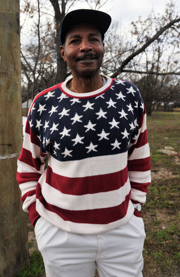 Jim Johnson from Adrian, Mi. and was attending his 21st MLK March, wears an American flag sweater. Photo: Robin Jerstad