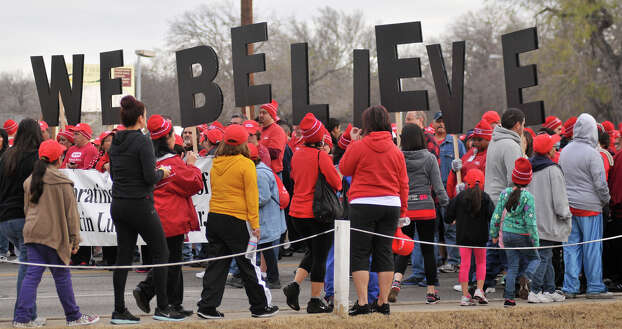 "HEB participants in the MLK March hold up the saying ""We Beliieve"" in over-sized letters at the start of the March Monday. Photo: Robin Jerstad"