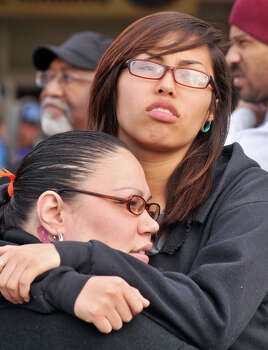 Shantell Rupard and her daughter, Tiffany Rupard, 16, hug at the start of the MLK March Monday. Photo: Robin Jerstad