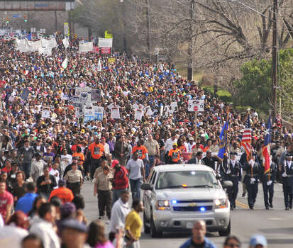 Thousands of people walk along Martin Luther King Dr. during the annual MLK March Monday morning. Photo: Robin Jerstad