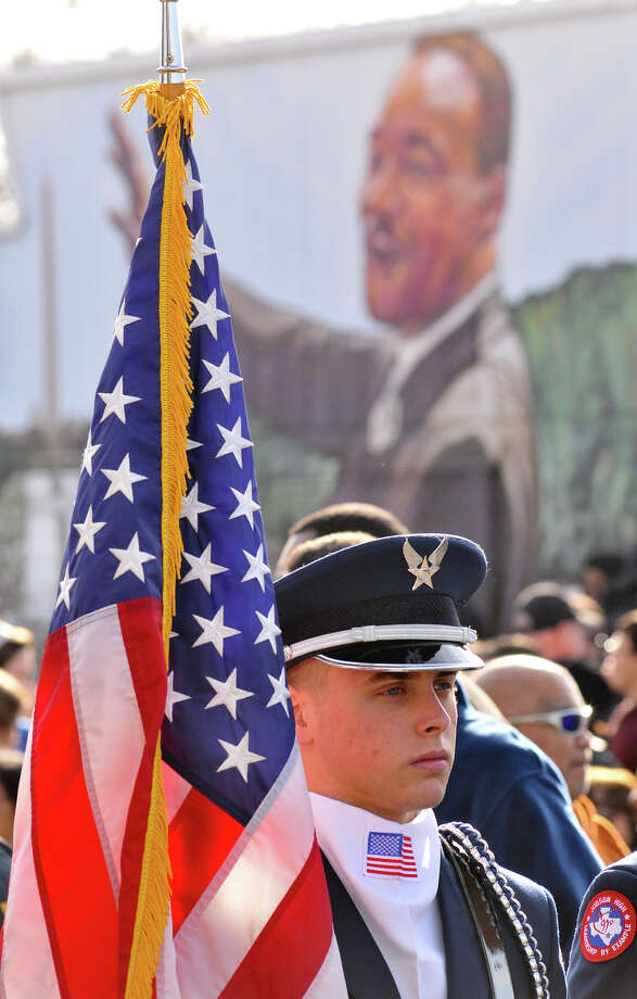 Richard Barker of the Judson High School ROTC holds the American flag prior to the start of the MLK March Monday. Photo: Robin Jerstad