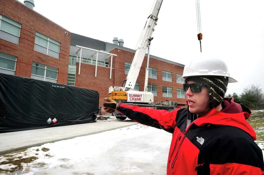 Kyle Johnson describes the installation of a new fuel cell at the science building on Western Connecticut State University's midtown campus Monday, Jan. 21, 2013. When complete, the cell will provide energy for the entire building. Photo: Michael Duffy
