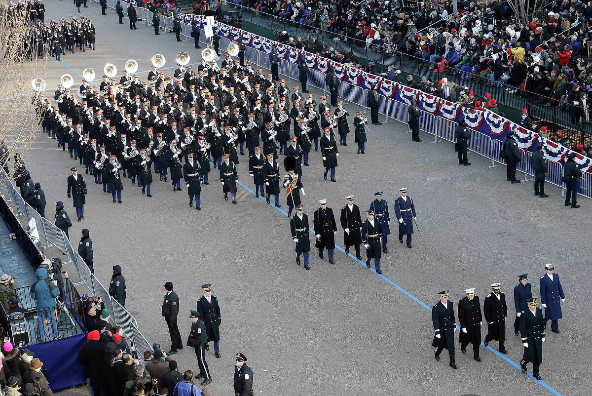 The U.S. Army band marches down Pennsylvania Avenue en route to the White House, Monday, Jan. 21, 2013, in Washington. Thousands marched during the 57th Presidential Inauguration parade after the ceremonial swearing-in of President Barack Obama. (AP Photo/Charlie Neibergall)