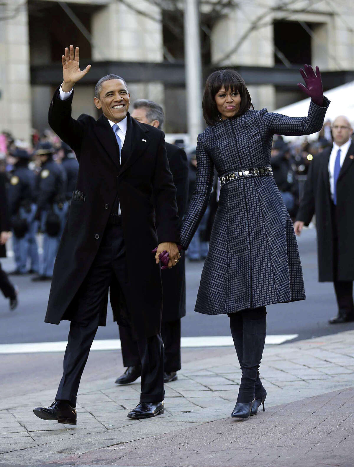 President Barack Obama and first lady Michelle Obama waves as they walk down Pennsylvania Avenue during the 57th Presidential Inauguration parade Monday, Jan. 21, 2013, in Washington. (AP Photo/Charles Dharapak)