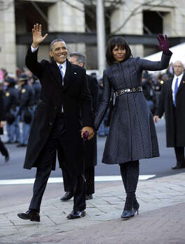 President Barack Obama and first lady Michelle Obama waves as they walk down Pennsylvania Avenue during the 57th Presidential Inauguration parade Monday, Jan. 21, 2013, in Washington. (AP Photo/Charles Dharapak) Photo: Charles Dharapak, ASSOCIATED PRESS / AP2013