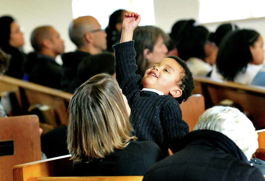 Kenneth Miller, 2, listens to George Coleman, the guest speaker at New Hope Baptist Church's 11th annual celebration honoring Dr. Martin Luther King Jr. Monday, Jan. 21, 2013 in Danbury. Photo: Michael Duffy / The News-Times