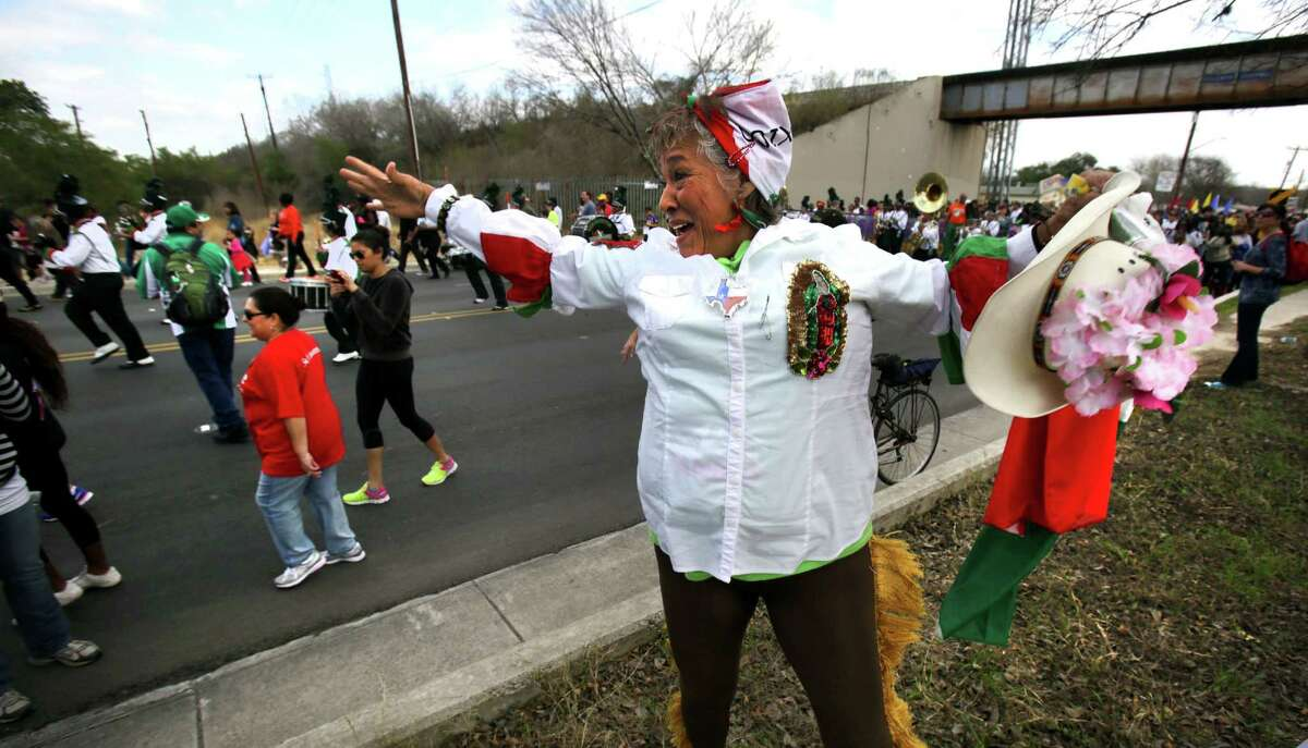 An exuberant Elva Jimenez Escalante dances as the Sam Houston H.S. Marching Band approaches at the Martin Luther King, Jr. March along MLK Blvd. Jan. 21, 2013.