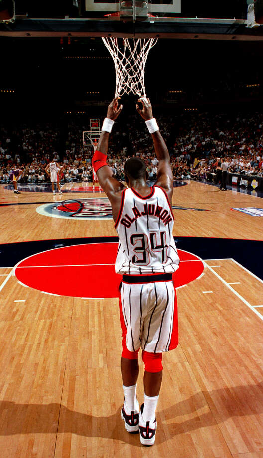 Hakeem finds some time to rest in the final minutes of a 1996 first-round playoff matchup against the Lakers. Photo: SMILEY N. POOL, Houston Chronicle / Houston Chronicle