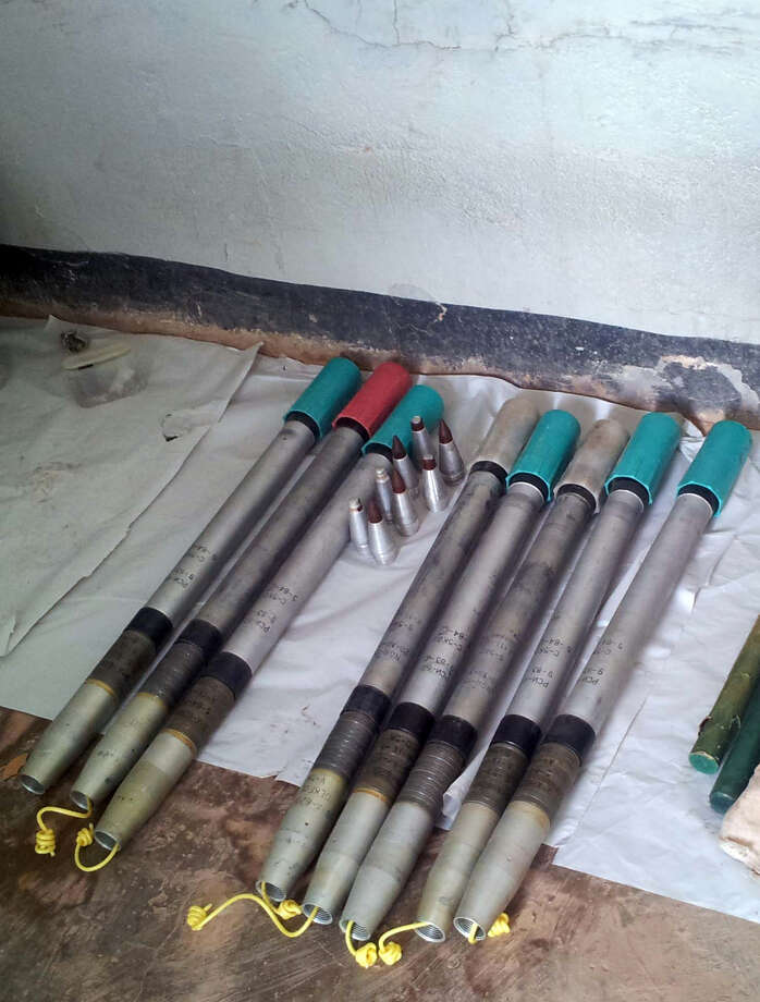 This recent but undated photo made available Monday Jan. 21, 2013, showing weapons and equipment arranged to show the media how Islamic militants were armed, at the natural gas plant they attacked and took hostages at Ain Amenas, Algeria.  The militants were wearing Algerian army uniforms and were equipped with explosives to blow up the plant, according to Algeria's Prime Minister Abdelmalek Sellal, who said Monday that at least 81 people died in the four-day operation by government forces to liberate the hostages, including 32 Islamist militants. Five foreigners are still reported as missing.(AP Photo) Photo: Associated Press / AP