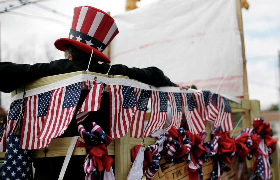A patriotic flat takes part in a march honoring Martin Luther King Jr., Monday, Jan. 21, 2013, in San Antonio. (AP Photo/Eric Gay) Photo: Eric Gay, Associated Press / AP
