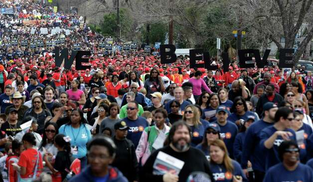 Thousands take part in an MLK Day march honoring Martin Luther King Jr., Monday, Jan. 21, 2013, in San Antonio. (AP Photo/Eric Gay) Photo: Eric Gay, Associated Press / AP