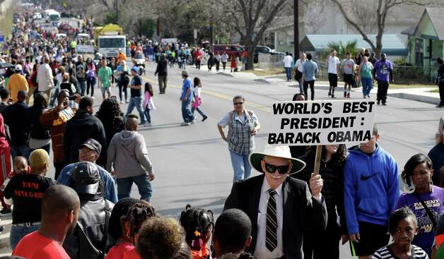 A man carries a sign supporting President Barack Obama during a march honoring Martin Luther King Jr., Monday, Jan. 21, 2013, in San Antonio. (AP Photo/Eric Gay) Photo: Eric Gay, Associated Press / AP