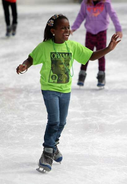 Julia Bevil, 9, skates The ICE at Discovery Green after attending the Matin Luther King Day parade i