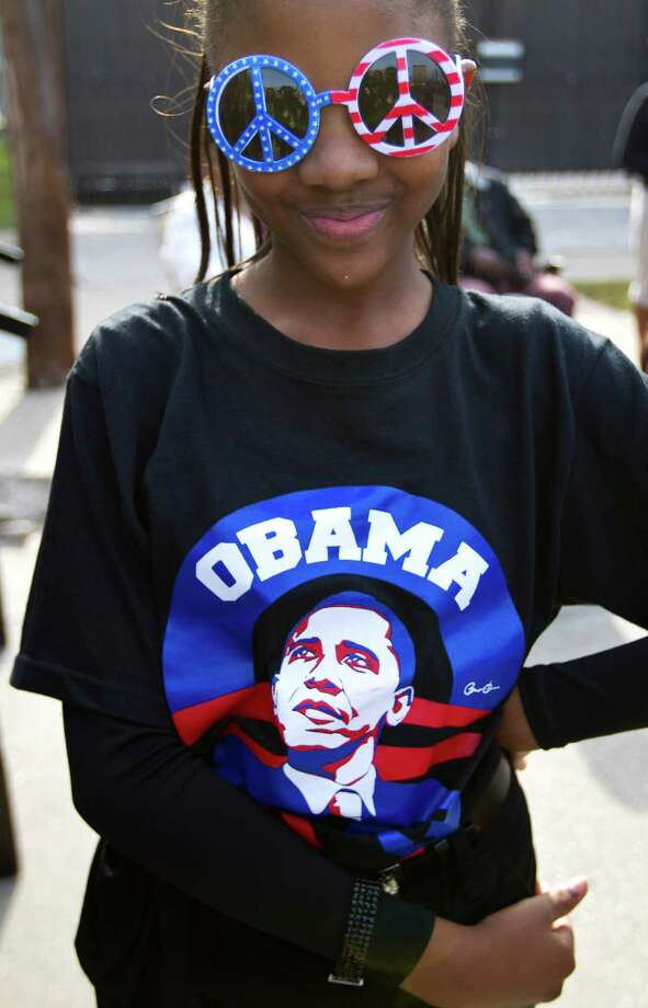 "Alexis Pryor, 10, with Team MBO (Michelle and Barack Obama) wears her ""peace"" glasses after performing with the Chameleon Band during the 19th Annual MLK Grande Parade by the MLK Parade Foundation, which started on San Jacinto and Rosalie Streets in Midtown, Monday, Jan. 21, 2013. Photo: Karen Warren, Houston Chronicle / © 2013 Houston Chronicle"