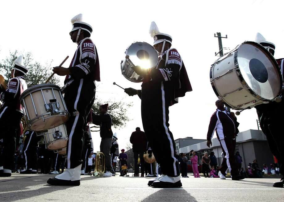 Drummers in a high school band march by during the 19th Annual MLK Grande Parade by the MLK Parade Foundation, which started on San Jacinto and Rosalie Streets in Midtown, Monday, Jan. 21, 2013. Photo: Karen Warren, Houston Chronicle / © 2013 Houston Chronicle