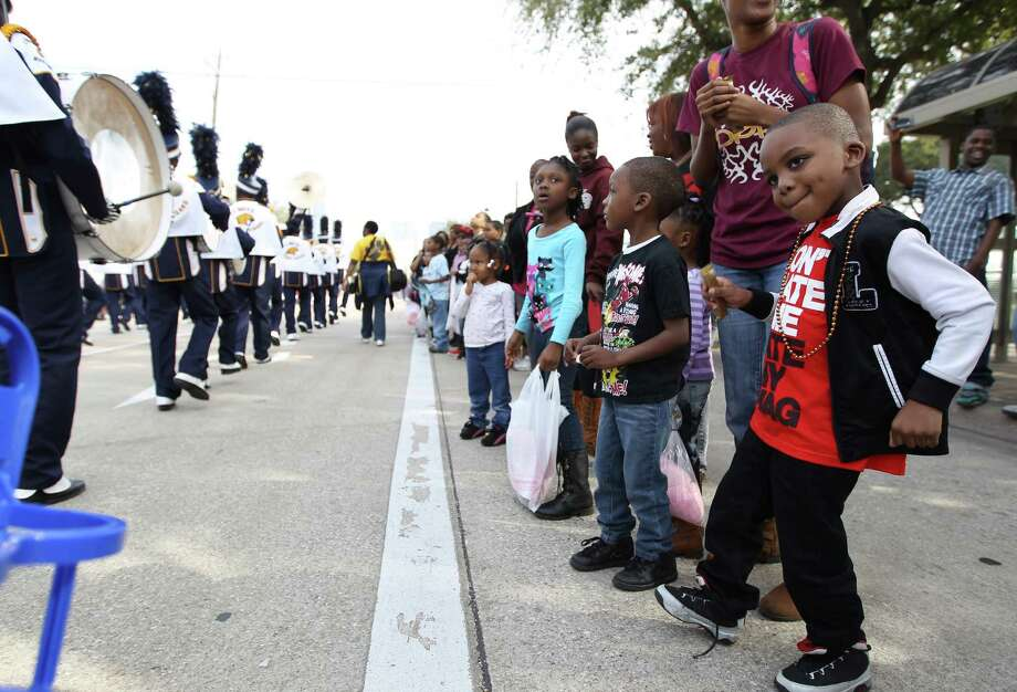 Joshua Richardson, 5, dances along with a marching band during the 19th Annual MLK Grande Parade by the MLK Parade Foundation, which started on San Jacinto and Rosalie Streets in Midtown, Monday, Jan. 21, 2013. Photo: Karen Warren, Houston Chronicle / © 2013 Houston Chronicle