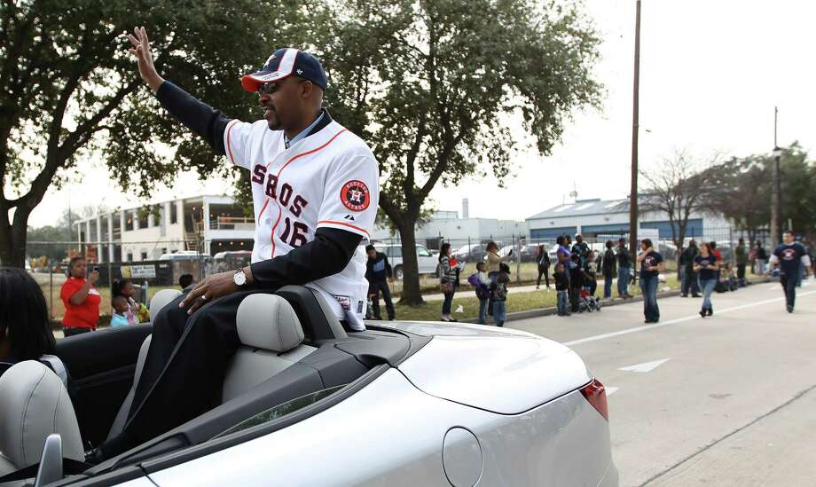 Houston Astros manager Bo Porter waves to the crowd from a convertible during the 19th Annual MLK Grande Parade by the MLK Parade Foundation, which started on San Jacinto and Rosalie Streets in Midtown, Monday, Jan. 21, 2013. Photo: Karen Warren, Houston Chronicle / © 2013 Houston Chronicle