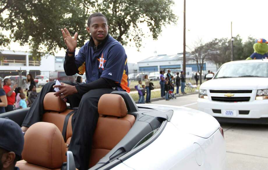 Houston Astros Wesley Wright waves to the crowd from a convertible during the 19th Annual MLK Grande Parade by the MLK Parade Foundation, which started on San Jacinto and Rosalie Streets in Midtown, Monday, Jan. 21, 2013. Photo: Karen Warren, Houston Chronicle / © 2013 Houston Chronicle