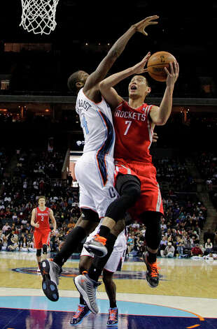Jeremy Lin is fouled as he drives to the basket against Bobcats forward Michael Kidd-Gilchrist during the first half. Photo: Chuck Burton, Associated Press / AP