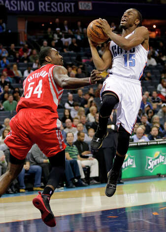 Kemba Walker drives past Patrick Patterson during the first half. Photo: Chuck Burton, Associated Press / AP