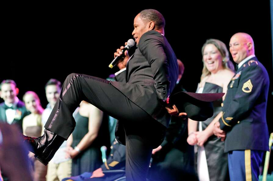 Actor Jamie Foxx shows his cowboy boots during the Black Tie & Boots ball as part of the Inaugural f