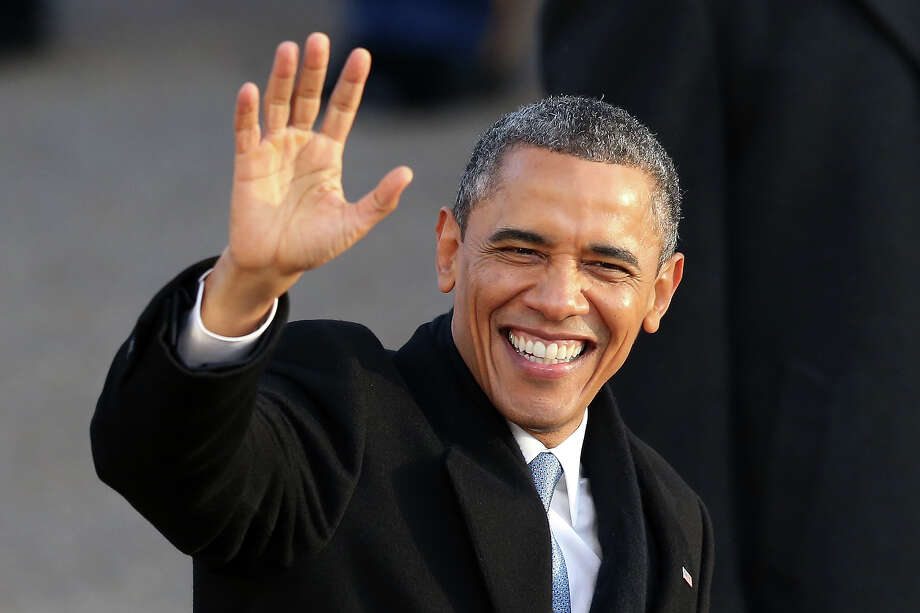 WASHINGTON, DC - JANUARY 21:  U.S. President Barack Obama waves as the presidential inaugural parade winds through the nation's capital January 21, 2013 in Washington, DC. Barack Obama was re-elected for a second term as President of the United States. Photo: Mark Wilson, Getty Images / 2013 Getty Images