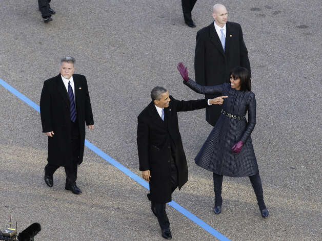 President Barack Obama and First Lady Michelle Obama walk along a stretch of Pennsylvania Avenue along the Parade Route during  the 57th Presidential Inauguration on January 21, 2013 in Washington, DC. AFP PHOTO/Yuri GRIPAS Photo: YURI GRIPAS, AFP/Getty Images / 2013 AFP