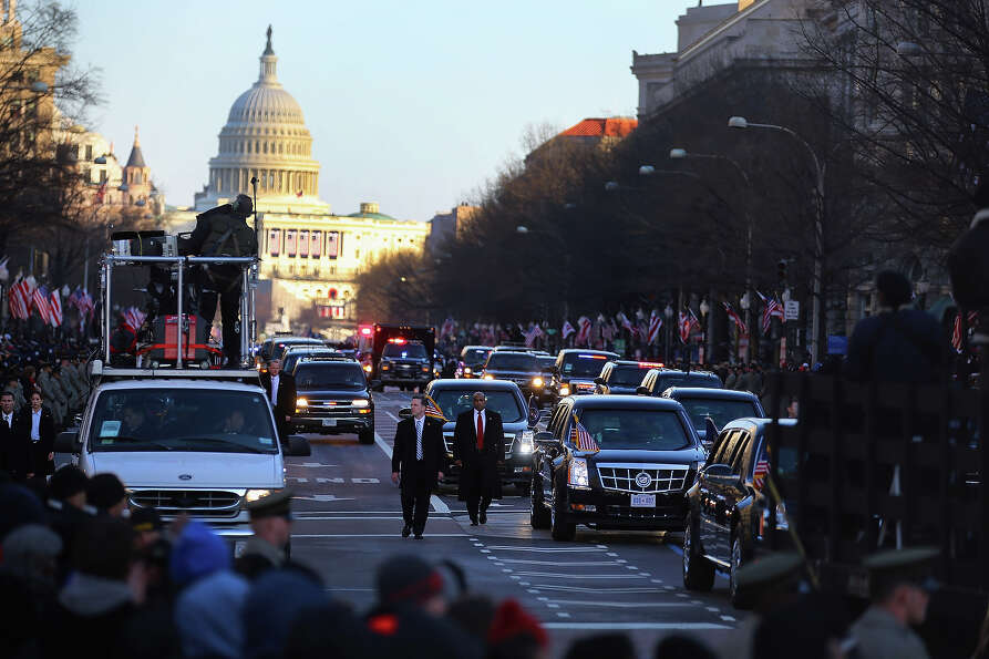 WASHINGTON, DC - JANUARY 21:  U.S. President Barack Obama drives down Pennsylvania avenue in his veh